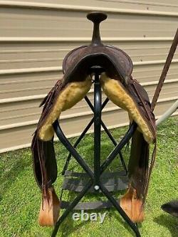 16 Antique A fork Western saddle withsteel horn, leather covered rigging
