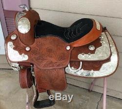 Used 15 western show saddle withsilver, tooled leather, stirrups adjust short
