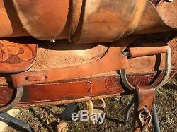 Used 16.5 Santa Fe Western roping saddle withtooled skirts, rough out fenders