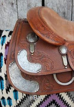 Used- Bob's 16 reining saddle with padded seat and hand engraved silver