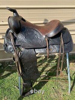 Used/Vintage 15 TexTan Western saddle withspiderweb tooling
