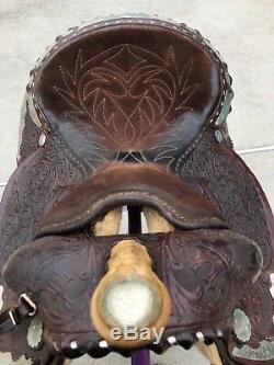 Used Vintage Circle Y western equitation saddle, dark brown fully tooled 15 inch