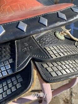 Used/vintage 15.5 black leather Western parade saddle withtapaderos, silver