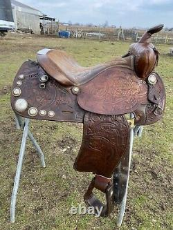 Used/vintage Simco 15 tooled Western saddle withsilver conchos